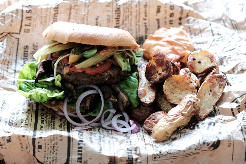 Vegan burger with roasted potatoes
